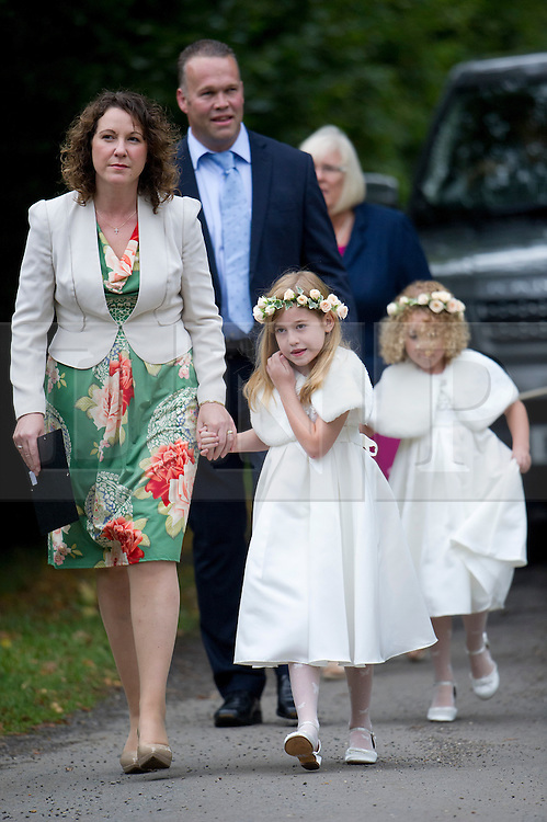 © London News Pictures. 14/09/2013.  Flower girls arriving at the wedding of Euan Blair, Son of former British Prime Minister Tony Blair,  to Suzanne Ashman at All Saints Parish Church in Wotton Underwood, Buckinghamshire. The wedding was attended by Former British Prime minister Tony Blair and his wife Cherie Blair. Photo credit: Ben Cawthra/LNP