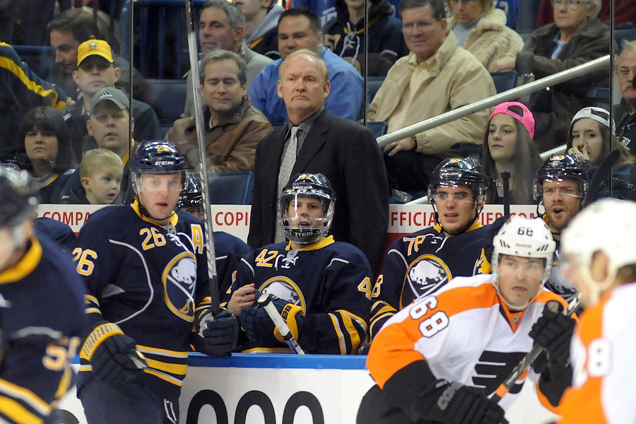 Buffalo Sabres head coach Lindy Ruff watches the first period from the bench as the Sabres battle the Philadelphia Flyers at the First Niagara Center in Buffalo, NY. Buffalo leads Philadelphia 3-1 after the first period.