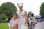 Family of racegoers at Ladies Day, Fontwell Park Racecourse, Arundel, United Kingdom on 13 August 2015. Photo by Phil Duncan.
