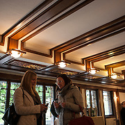 The National Park Service announced the Robie House, the 1910 masterpiece by architect Frank Lloyd Wright built in his classic Prairie Style, has been submitted to UNESCO for World Heritage nomination. Wright built the house for Frederick C. Robie on the campus of the University of Chicago in the neighborhood of Hyde Park in Chicago.  Designers Paula Bodnar Schmitt, left and Lisa Frye, tour the Robie House. <br /> Photography by Jose More