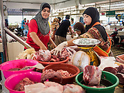 18 JUNE 2015 - PATTANI, PATTANI, THAILAND: Women sell meat in the market in Pattani. Many Thai Muslims go shopping early in the day to buy food for Iftar, the meal that breaks the day long Ramadan fast.    PHOTO BY JACK KURTZ