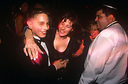 The mother of a young 13 year-old Jewish boy helps celebrate his coming-of-age at his bar mitzvah party, on 12th February 2001, in London, England.