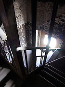 dark fire escape stairway in industrial building looking down