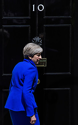 © Licensed to London News Pictures. 09/06/2017. London, UK. British prime minister  THERESA MAY arrives back at 10 Downing Street in London, following a meeting with Queen Elizabeth II, in which she asked to form a new government. The Conservative Party made substantial losses in an election that they were expected to win comfortably. Photo credit: Ben Cawthra/LNP