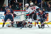 KELOWNA, BC - DECEMBER 27:  Mark Liwiski #9 and Alex Swetlikoff #17 of the Kelowna Rockets look for the rebound shot as Dylan Garand #31 of the Kamloops Blazers makes a firt period save at Prospera Place on December 27, 2019 in Kelowna, Canada. (Photo by Marissa Baecker/Shoot the Breeze)