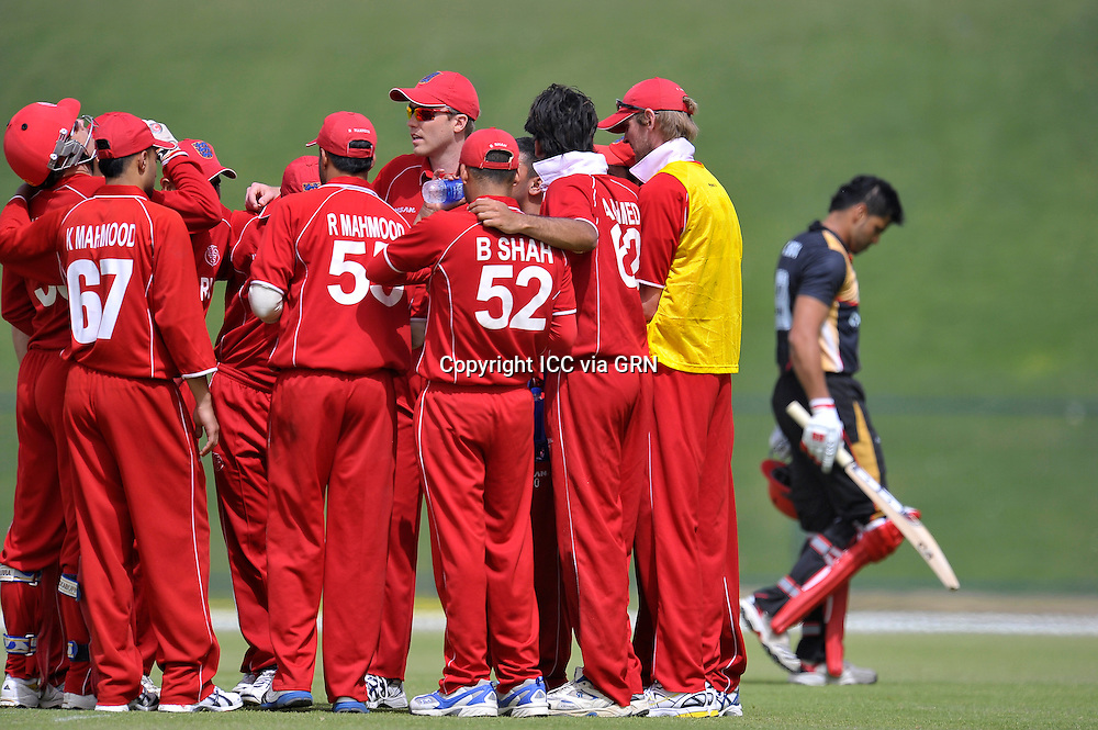 The Danish re-group after the fall of the Canadian Captain Rizwan Cheema at the ICC World Twenty20 Qualifier UAE 2012.. Pix ICC/Thusith Wijedoru