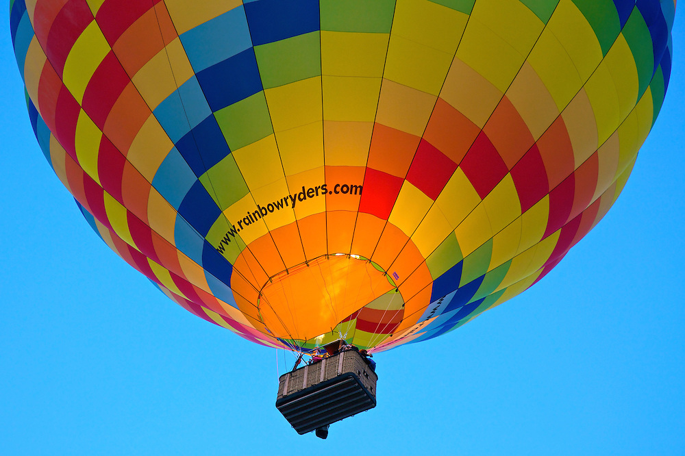 Tourists take a high flying ride on one of Rainbow Ryders hot air balloons during Albuquerque's annual Balloon Fiesta