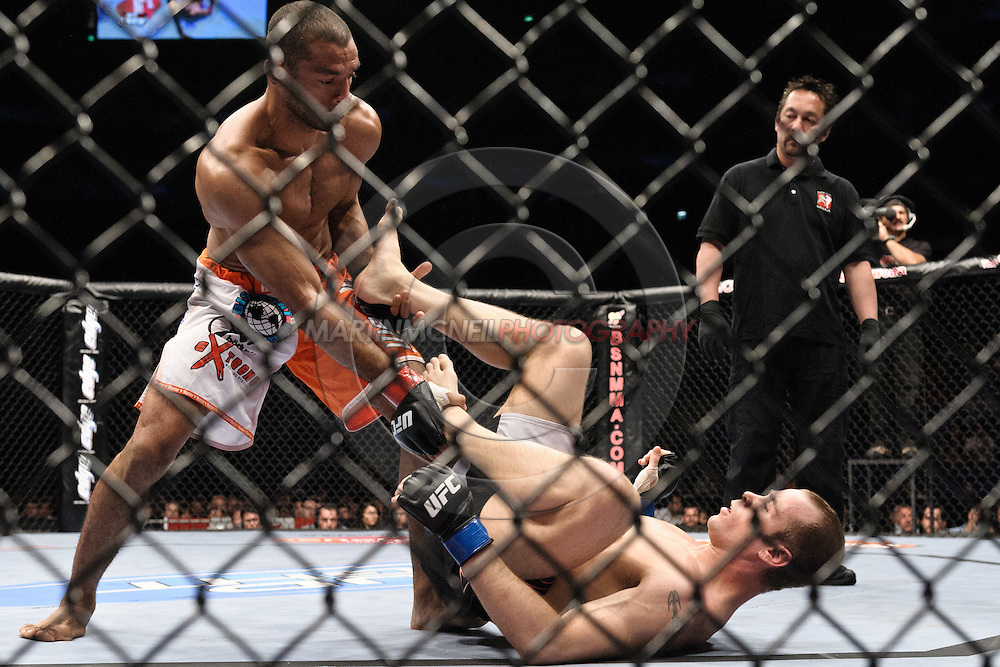 """LONDON, ENGLAND, JUNE 7, 2008: Roan Carneiro (left) attempts to control a grounded Kevin Burns during """"UFC 85: Bedlam"""" inside the O2 Arena in Greenwich, London on June 7, 2008."""