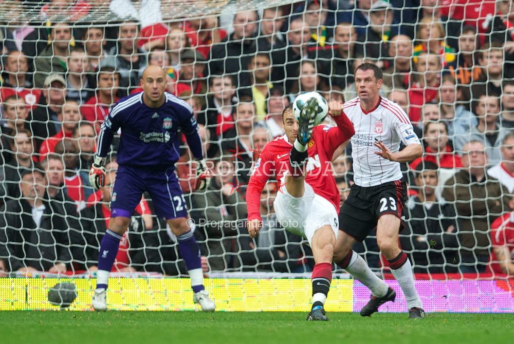 MANCHESTER, ENGLAND - Sunday, September 19, 2010: Manchester United's Dimitar Berbatov scores his side's second goal against Liverpool during the Premiership match at Old Trafford. (Photo by David Rawcliffe/Propaganda)