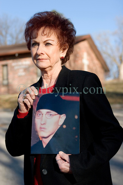 19 Jan, 2006. Eminem's maternal grandmother Betty Kresin holds up a photograph of her grandson outside The South Park assembly of God near St Joseph, Kansas. A small rural church where rap star Marshall Bruce Masthers III, aka Eminem first married Kim in 1999. Betty is sad and upset that her grandson did not invite her to his recent wedding and re-marriage to Kim in 2006.<br /> Photo; Charlie Varley/varleypix.com
