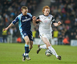 MILTON KEYNES, ENGLAND - Saturday, January 23, 2010: Tranmere Rovers' Tranmere's Craig Curran and MK Dons' Dean Lewington in action during the Football League One match at Stadium MK. (Photo by Gareth Davies/Propaganda)