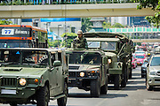25 MAY 2014 - BANGKOK, THAILAND: A convoy of soldiers arrives at an anti-coup protest in Bangkok. Public opposition to the military coup in Thailand grew Sunday with thousands of protestors gathering at locations throughout Bangkok to call for a return of civilian rule and end to the military junta.     PHOTO BY JACK KURTZ
