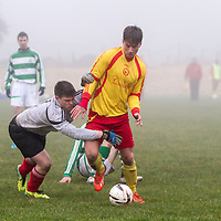 Avenue A's Stephen McGann tries to get around the Rhine Rover's goalie, Martin O'Meara