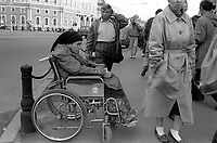 Woman in wheel chair begging on the streets. <br />
