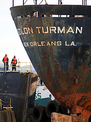 Crowds gather to watch the arrival of the Solon Turman, floats past the caisson  into the newly re-opened dry docks located on Mare Island in Vallejo, Calif.  California Dry Dock Solutions was recently awarded a $3.1 Million contract from the U.S.Navy to dismantle two ships  currently located in Suisun Bay.