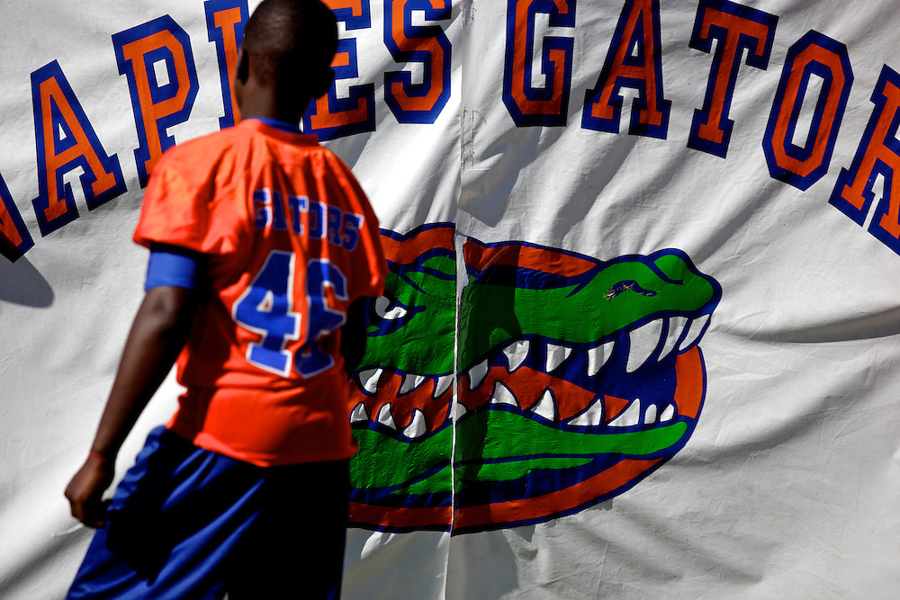 A banner for players to run through, displays the well-known Florida logo of the alligator, used by The University of Florida, as well as hundreds of other organization and pee-wee football teams, such as the Naples Gators. The alligator has become an unoffical mascot of Florida.