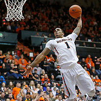 Oregon State's Gary Payton II goes for a dunk in the first half of an NCAA college basketball game agaisnt USC, in Corvallis, Ore., on Sunday, Jan. 24, 2016.  (AP Photo/Timothy J. Gonzalez)