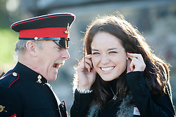 Miss Scotland Jennifer Reochs with Gunner Jamie Shannon..The Miss World participants visit Edinburgh Castle and will witness the firing of the One O'clock gun..MISS WORLD 2011 VISITS SCOTLAND..Pic © Michael Schofield.