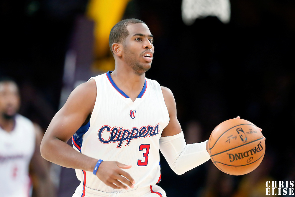 31 October 2014: Los Angeles Clippers guard Chris Paul (3) brings the ball up court during the Los Angeles Clippers 118-111 victory over the Los Angeles Lakers, at the Staples Center, Los Angeles, California, USA.