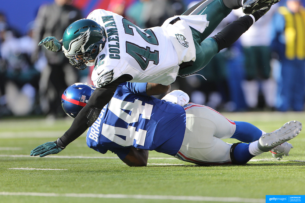 Ahmad Bradshaw, Giants, is tackled by Kurt Coleman, Eagles,  during the New York Giants V Philadelphia Eagles NFL American Football match at MetLife Stadium, East Rutherford, NJ, USA. 30th December 2012. Photo Tim Clayton