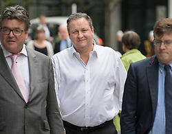 © Licensed to London News Pictures. 03/07/2017. London, UK. Newcastle United owner Mike Ashley  (C) arrives at the High Court. Mr Ashley is in dispute with financial expert  Jeffrey Blue over payments promised in relation to the share price of Sports Direct. Photo credit: Peter Macdiarmid/LNP