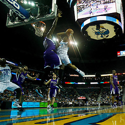 December 15, 2010; New Orleans Hornets guard Marcus Thornton (5) shoots over Sacramento Kings center Samuel Dalembert (10) during the first half at the New Orleans Arena. The Hornets defeated the Kings 94-91. Mandatory Credit: Derick E. Hingle