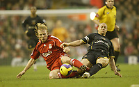 Photo: Aidan Ellis.<br /> Liverpool v Watford. The Barclays Premiership. 23/12/2006.<br /> Liverpool's Dirk Kuyt (L) and Watford's Gavin Mahon challenge for the ball