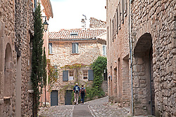 An unidentied couple explore the medieval Upper Town of Vaison-la-Romaine.