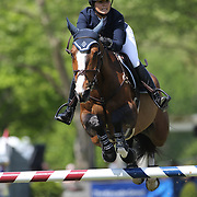 Maggie McAlary riding HH Donnatella in action during the $100,000 Empire State Grand Prix presented by the Kincade Group during the Old Salem Farm Spring Horse Show, North Salem, New York,  USA. 17th May 2015. Photo Tim Clayton