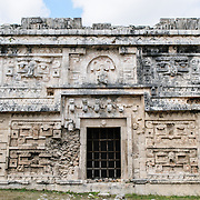 "Intricately decorated buildings at Chichen Itza, a pre-Columbian archeological site in Yucatan, Mexico. This building is known as ""La Iglesia"" and is in the Las Monjas complex of buildings."