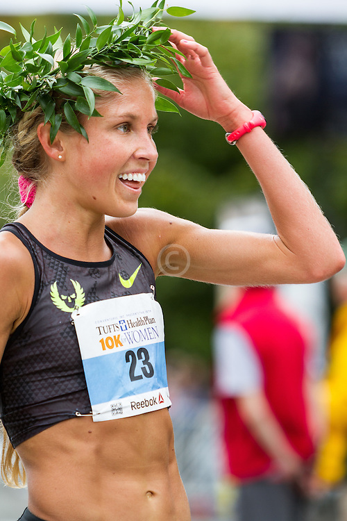 Tufts Health Plan 10K for Women Jordan Hasay wears winner's laurel wreath after running 31:38