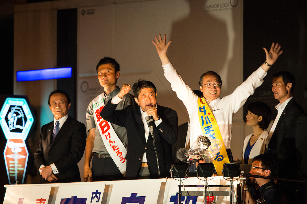 TOKYO, JAPAN - JULY 9 :  Japanese Prime Minister Shinzo Abe, president of the ruling Liberal Democratic Party (LDP), delivers a campaign speech to support candidate Masaharu Nakagawa and candidate Kentaro Asahi, Tarō Asō also attended the campaign during the last day of the Upper House election campaign outside of Akihabara Station in Tokyo, Japan on July 9, 2016. Tomorrow, July 10, 2016 will be the first Upper house election nation-wide in Japan that 18 years old can vote after government law changes its voting age from 20 years old to 18 years old. (Photo by Richard Atrero de Guzman/NURPhoto)