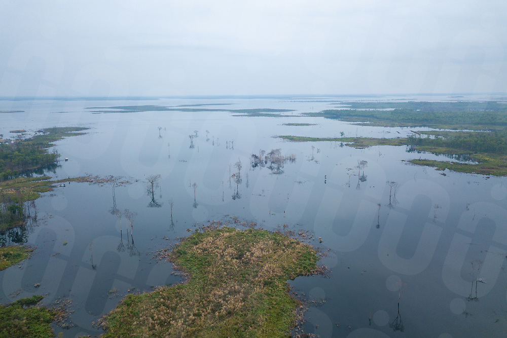 April 27, 2018 - Stung Treng (Cambodia). Aerial view of the Lower Sesan 2 dam's reservoir. With the closing of the dam's gates, the villages of Kbal Romeas and nearby Srekor were flooded and a massive lake now covers what once were hectares of ancestral forests and rice fields and dozen of families of fishermen have moved from other Cambodian provinces to take advantage of the abundance of fish. © Thomas Cristofoletti / Ruom