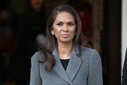 © Licensed to London News Pictures. 05/12/2016. London, UK. Campaigner Gina Miller (C) stops for photographers as she arrives at the Supreme Court  in Westminster, London for first day of a Supreme Court hearing to appeal against a November 3 High Court ruling that Article 50 cannot be triggered without a vote in Parliament. Photo credit: Peter Macdiarmid/LNP