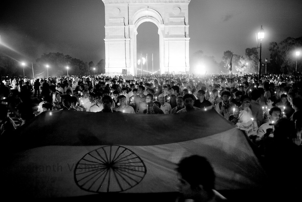 Supporters of social activist Anna Hazare conduct a candlelight vigil in New Delhi, India, on Thursday, April 7, 2011. Hazare has vowed to fast to the death to rid India of the corruption he says is its biggest curse. Photographer: Prashanth Vishwanathan
