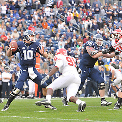 Oct 31, 2009; East Hartford, CT, USA; Connecticut quarterback Zach Frazer (10) stands in the pocket with Rutgers defensive tackle Justin Francis (91) cosing during second half Big East NCAA football action in Rutgers' 28-24 victory over Connecticut at Rentschler Field.