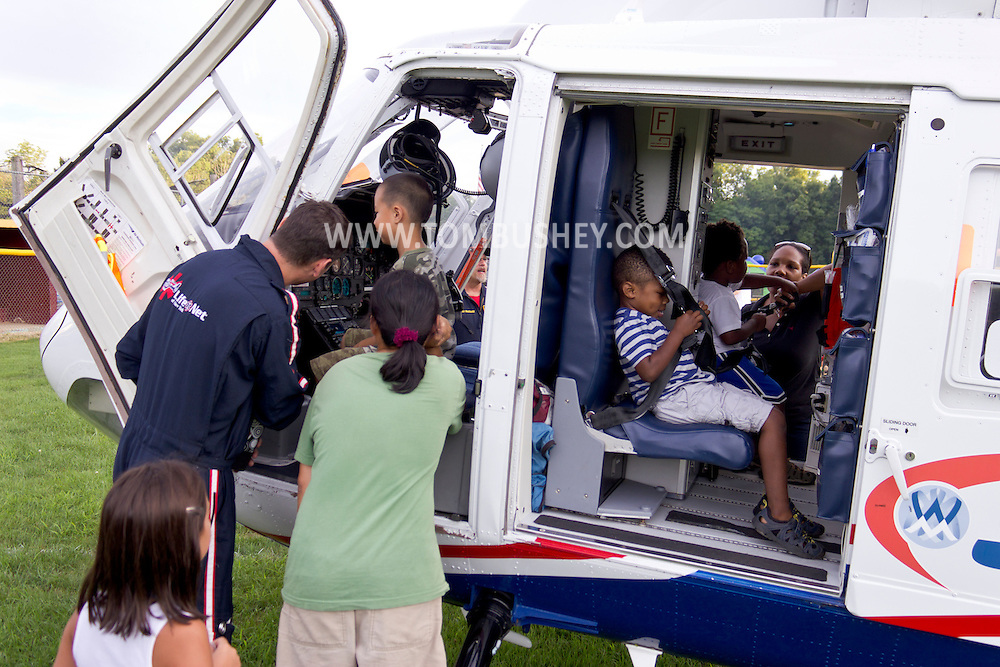 Scotchtown, New York - People look at a STAT Flight medical evacuation helicopter that landed on the Little League field during a Night Out Against Crime event on on Aug. 7, 2012. The helicopter is a twin-engine American Eurocopter BK-117.