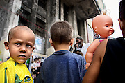 Two brothers and a sister, a few kids of the 315 children that were living at the Prestes Maia building, in a day of protests.