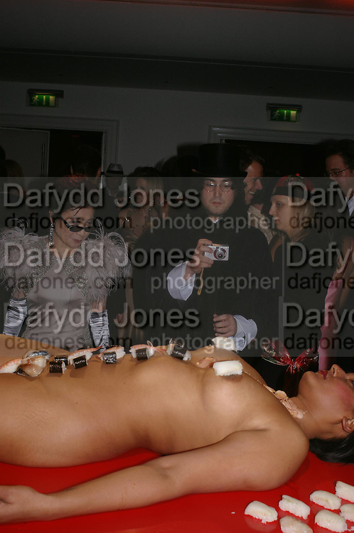 Yoko Ono and Sean Lennon. Andy & Patti Wong's Chinese New Year party to celebrate the year of the Rooster held at the Great Eastern Hotel, Liverpool Street, London.29th January 2005. The theme was a night of hedonism in 1920's Shanghai. . ONE TIME USE ONLY - DO NOT ARCHIVE  © Copyright Photograph by Dafydd Jones 66 Stockwell Park Rd. London SW9 0DA Tel 020 7733 0108 www.dafjones.com