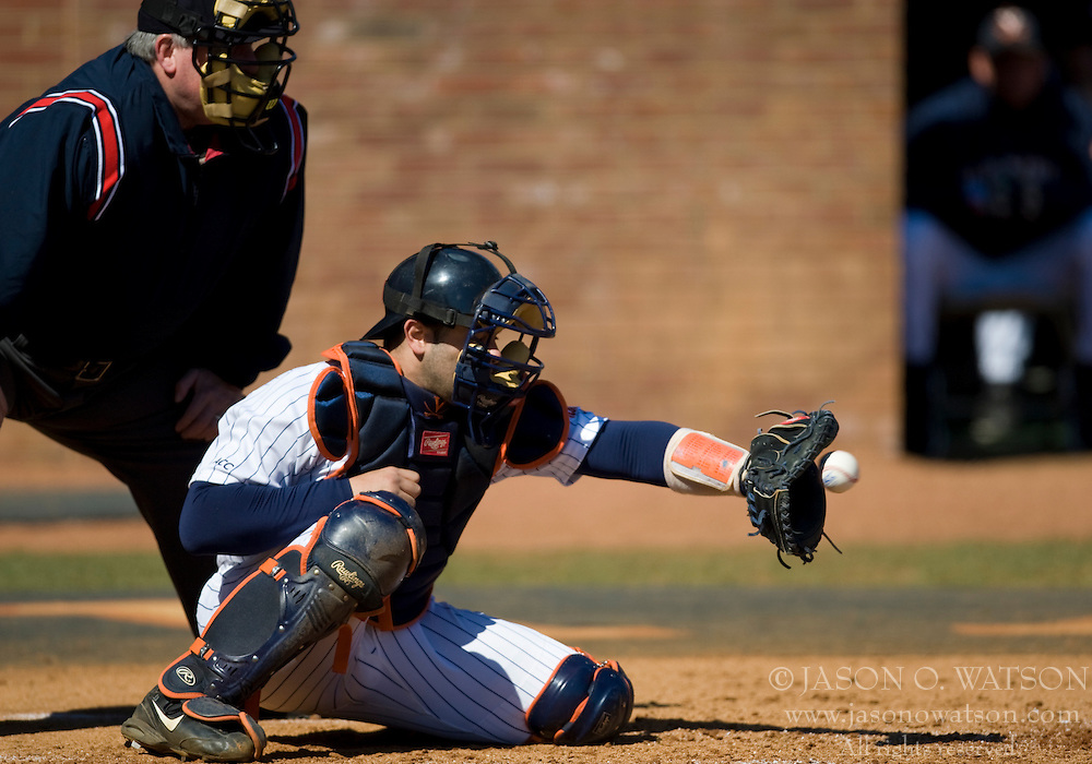 Virginia Cavaliers C Franco Valdes (33) catches a Virginia Cavaliers LHP Pat McAnaney (19) pitch.  The #16 ranked Virginia Cavaliers baseball team defeated the Cornell Big Red 12-2 at the University of Virginia's Davenport Field in Charlottesville, VA on March 1, 2008.