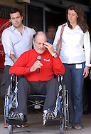 CAMDEN, NJ - APRIL 30:  New Jersey Governor Jon Corzine is wheeled out of Cooper University Hospital by his son Jeff (L) and daughter Jennifer (R) April 30, 2007 in Camden, New Jersey. Corzine has been at the hospital while recuperating from a car accident on the Garden State Parkway in early April. (Photo by William Thomas Cain/Getty Images)