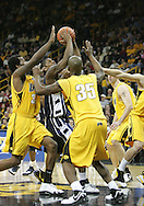 24 JANUARY 2007: Penn State guard/forward Geary Claxton (5) tries to get a shot off in Iowa's 79-63 win over Penn State at Carver-Hawkeye Arena in Iowa City, Iowa on January 24, 2007.