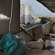 "Italy, Scampia (Naples). On November 10 it started emptying of the ""Vele"", buildings became famous worldwide as one of the most important centers of crime and drug dealing. Families, after almost forty years in the ""Vele"", received new apartments in which to move, the old structures, however, will be demolished to facilitate the resumption of the neighborhood and eliminate the huge degradation. The housing complex of ""Vele"" of Scampia, designed by Franz Di Salvo, was illegally occupied by many families left homeless after the 1980 Irpinia earthquake. The celebrity of ""Vele"" is also due to the film ""Gomorrah"" directed by Matteo Garrone and the homonym TV series. Italy, Scampia (Naples). On November 10 it started emptying of the ""Vele"", buildings became famous worldwide as one of the most important centers of crime and drug dealing. Families, after almost forty years in the ""Vele"", received new apartments in which to move, the old structures, however, will be demolished to facilitate the resumption of the neighborhood and eliminate the huge degradation. The complex of ""Vele"", designed by Franz Di Salvo, was illegally occupied by many families left homeless after the 1980 Irpinia earthquake. The celebrity of ""Vele"" is also due to the film ""Gomorrah"" and TV series."