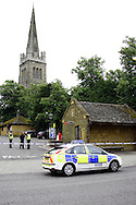 Police officers seure the scene of a sudden Death in a car park of Sheep street in Kettering, northants