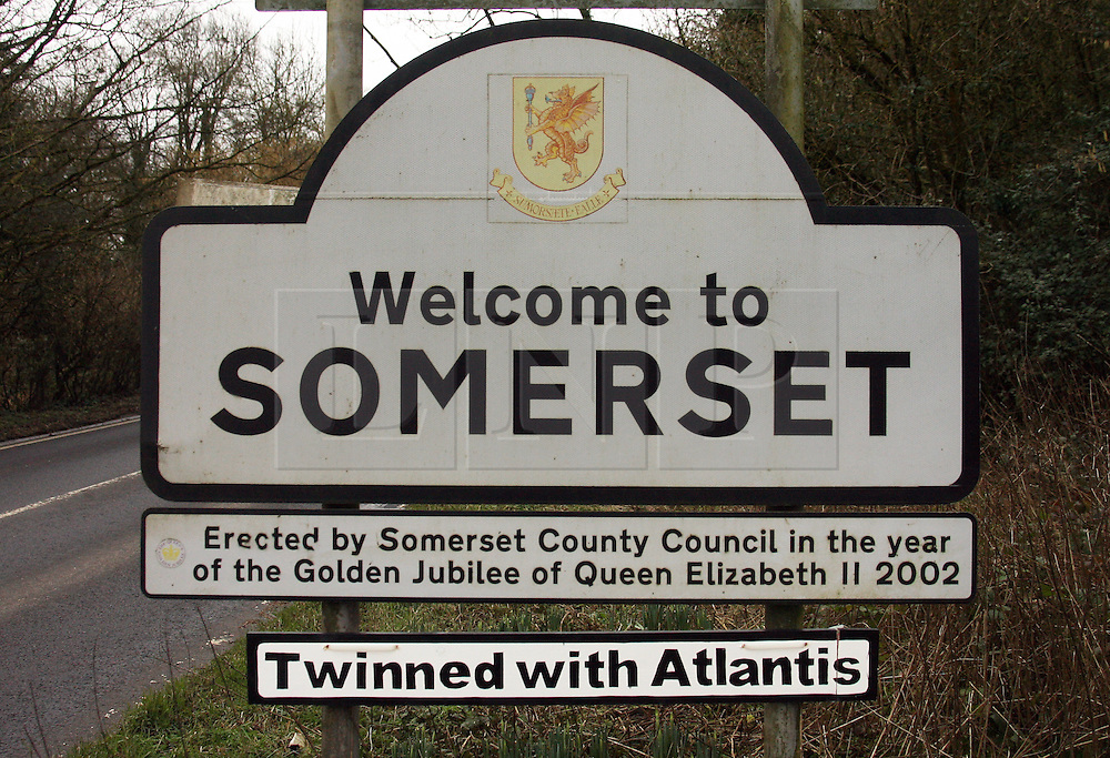 """© Licensed to London News Pictures. 02/03/2014. Somerset, UK A sign saying """"Twinned with Atlantis"""" has appeared on the Welcome to Somerset sign in Somerset. The sign appeared on Saturday morning In reference the recent floods the county has suffered. Photo credit : Jason Bryant/LNP"""