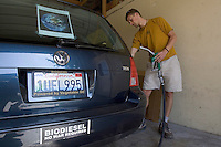 BERKELEY, CA - SEPTEMBER 1: Nick Hedlund of Berkeley, CA fills up his diesel car with biodiesel fuel at the Biofuel Oasis on September 1, 2005 in Berkeley, California. WIth gas prices rising and tax incentives motorists are starting to turn to alternative means to fuel their vehicles.  (Photograph by David Paul Morris)