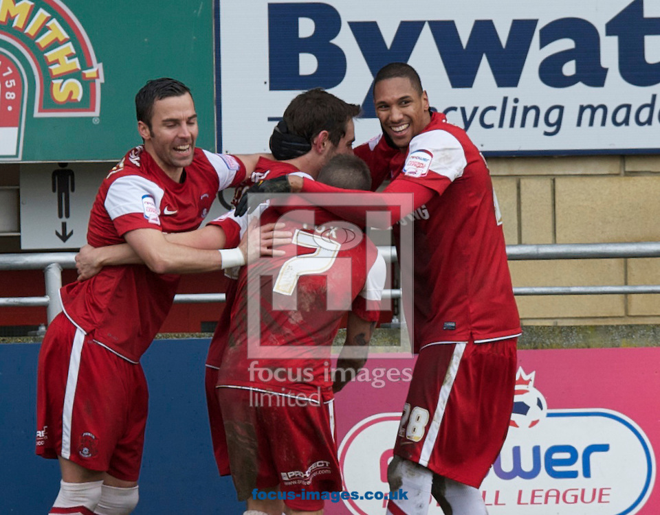 Picture by Alan Stanford/Focus Images Ltd +44 7915 056117.16/03/2013.(LtoR)Leon McSweeney  Dean Cox and Shaun Batt of Leyton Orient congratulate Romain Vincelot ( centre) during the npower League 1 match at the Matchroom Stadium, London..
