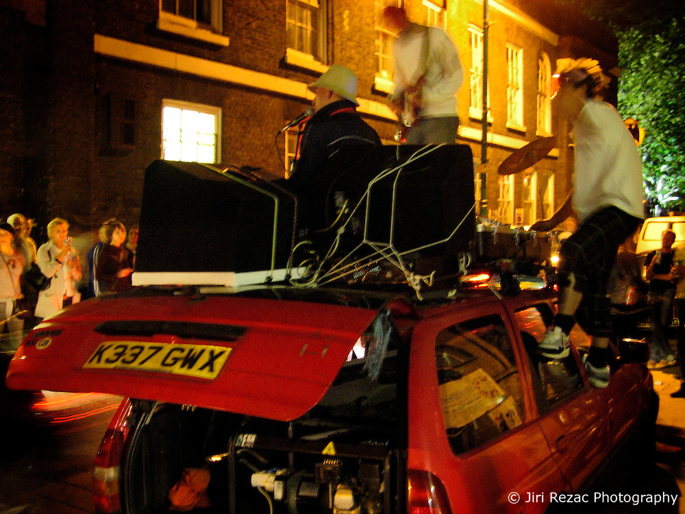 UK ENGLAND LONDON 15JUL06 - Summer Holiday band performs on top of their car in Brick Lane, East London during a weekend evening...jre/Photo by Jiri Rezac..© Jiri Rezac 2006..Contact: +44 (0) 7050 110 417.Mobile:  +44 (0) 7801 337 683.Office:  +44 (0) 20 8968 9635..Email:   jiri@jirirezac.com.Web:    www.jirirezac.com..© All images Jiri Rezac 2006 - All rights reserved.