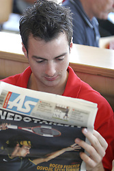 Aleksandar Capin reading sports newspaper As at press conference of Slovenian basketball National Team before departure to European Championships Belgrade 2005, on September 13, 2005, City park, BTC, Ljubljana, Slovenia.  (Photo by Vid Ponikvar / Sportida)