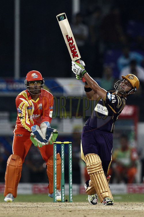 Gautam Gambhir captain of the Kolkata Knight Riders hit the shot during match 7 of the Oppo Champions League Twenty20 between the Kolkata Knight Riders and the Lahore Lions held at the Rajiv Gandhi Cricket Stadium, Hyderabad, India on the 21st September 2014<br /> <br /> Photo by:  Deepak Malik / Sportzpics/ CLT20<br /> <br /> <br /> Image use is subject to the terms and conditions as laid out by the BCCI/ CLT20.  The terms and conditions can be downloaded here:<br /> <br /> http://sportzpics.photoshelter.com/gallery/CLT20-Image-Terms-and-Conditions-2014/G0000IfNJn535VPU/C0000QhhKadWcjYs